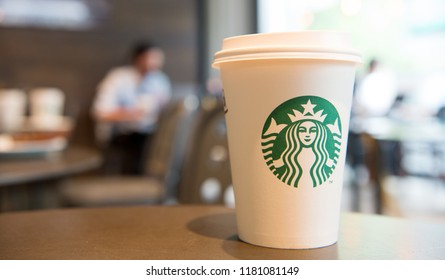 Berlin, Germany - May 31.2017: starbucks coffee cup in cafe shop, copy space. starbucks is largest coffee house with famous emblem. takeaway coffee. perfect morning with starbucks.