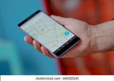 Berlin, Germany - May 4, 2017: finding a location on google maps using the mobile gps navigation with a Huawei smartphone. Selective focus