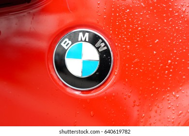 Berlin, Germany - May 4, 2017: Bmw motor company badge on red car. BMW (Bayerische Motoren Werke) is a German automobile, motorcycle and engine manufacturing company founded in 1916