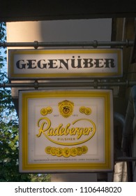 Berlin, Germany - May 4, 2018: Signage of the Gegenüber restaurant, located in Erich-Weinert-Straße, Prenzlauer Berg district in Berlin