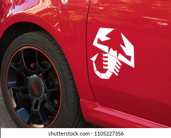 Berlin, Germany - May 5, 2018: Fiat 500 Abarth's scorpion badge. Abarth SpA is a racing car and road car maker founded by Italo-Austrian Abarth in 1949. Its logo is a shield with a scorpion