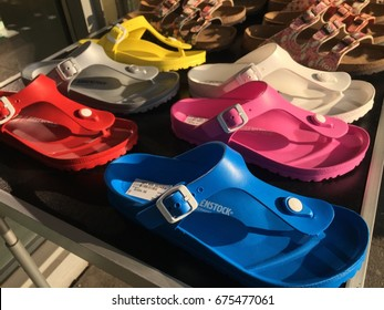 Berlin, Germany - May 6, 2017: Birkenstock sandals displayed in shoe store. The company is a famous German brand of sandals and other shoes notable for their contoured cork and rubber footbeds