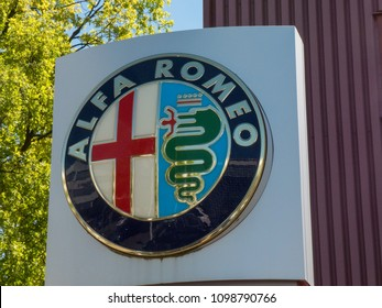 Berlin, Germany - May 6, 2018: Alfa Romeo car dealership signboard. Alfa Romeo Automobiles S.p.A. is an Italian manufacturer of cars