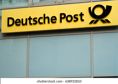 Berlin, Germany - May 7, 2017: Deutsche Post sign outside an office. Headquartered in Bonn, Deutsche Post DHL Group is a German courier company and the world's largest