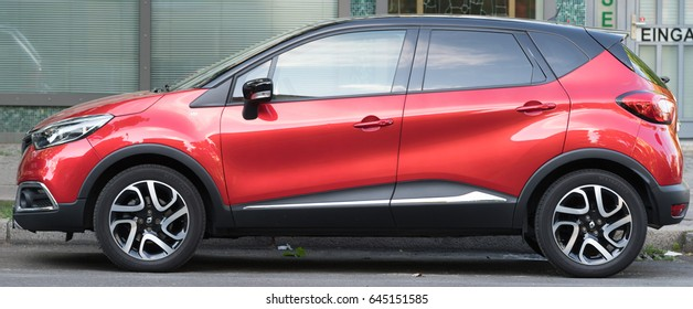 Berlin, Germany - May 7, 2017: Renault red shiny car. Side view. Groupe Renault is a French multinational automobile manufacturer established in 1899. The company produces a range of cars and vans