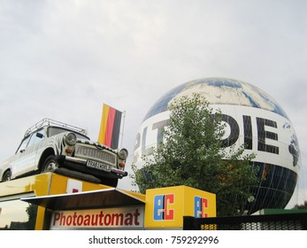 BERLIN, GERMANY - MAY 9,2016: Trabi World Museum of Classic Vintage Cars Outdoor View. Retro German Car Exposition right next to Checkpoint Charlie. Summer Scene with Empty Sky Background Copy Space.