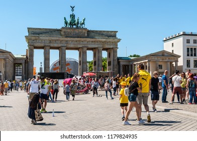 Berlin, Germany - May27, 2017: Tourists visiting the Brandenburger Tor (Brandenburg Gate) linking East and West Berlin. It's an 18th-century neoclassical triumphal arch in Berlin, landmarks of Germany