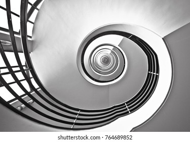 BERLIN, GERMANY - NOV 07,2016: Spiral modern black and white staircase in the business center near the streets of Kantstrass?e and Kurfurstendamm. Look down.