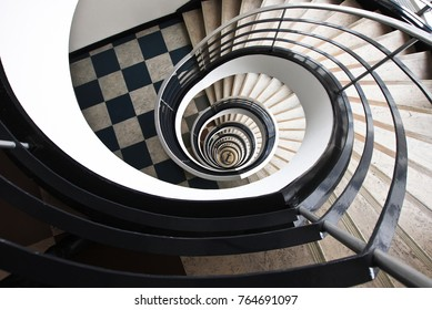 BERLIN, GERMANY - NOV 07,2016: Spiral round staircase in the business center near the streets of Kantstrass?e and Kurfurstendamm. Lookup.