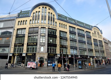 Berlin, Germany - November 10, 2018. Exterior view of Hackesche Hofe courtyard complex in Berlin, with commercial properties and people.