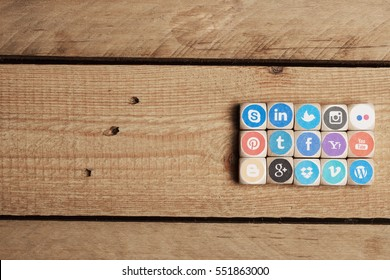 BERLIN, GERMANY - NOVEMBER 11, 2014: Logos of different social media services on dices, concept image for sharing content online.