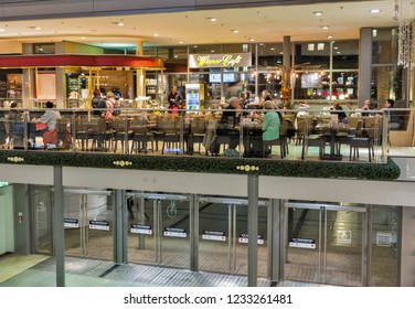 BERLIN, GERMANY - NOVEMBER 13, 2018: Unrecognized people visit Wiener Cafe in Potsdamer Platz Arkaden shopping mall. Berlin is the capital and German largest city by both area and population.