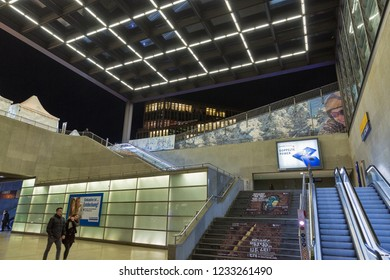 BERLIN, GERMANY - NOVEMBER 13, 2018: People visit Bahnhof Potsdamer Platz station. Night entrance to the railway station on one of the main public square and traffic intersection in the city centre.
