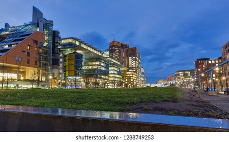 BERLIN, GERMANY - NOVEMBER 13, 2018: Modern futuristic architecture at night in Tilla Durieux Park in front of Potsdamer Platz. Berlin is the capital and German largest city by area and population.