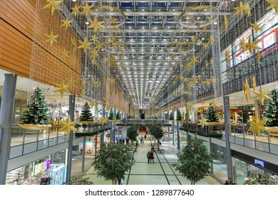 BERLIN, GERMANY - NOVEMBER 13, 2018: Unrecognized people visit Potsdamer Platz Arkaden shopping mall. Berlin is the capital and German largest city by both area and population.