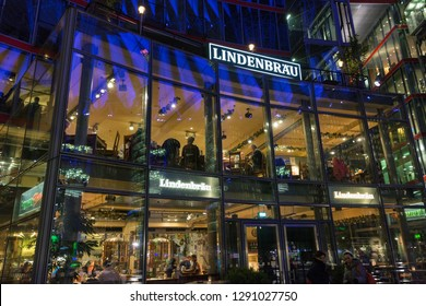 BERLIN, GERMANY - NOVEMBER 13, 2018: Unrecognized people visit night Lindenbrau traditional German beer and food restaurant inside of the Sony Center on Potsdamer Platz.