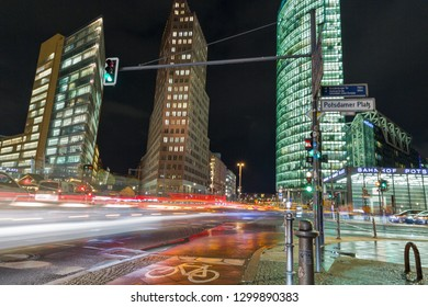 BERLIN, GERMANY - NOVEMBER 13, 2018: City night traffic on Potsdamer Platz. Entrance to the Bahnhof railway station on one of the main public square and traffic intersection.
