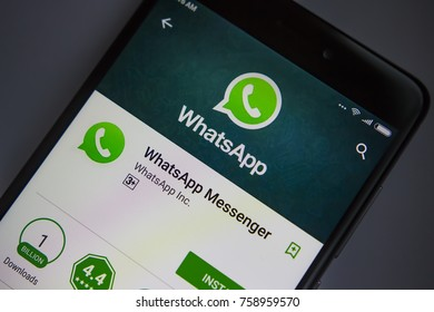 Berlin, Germany - November 19, 2017: WhatsApp application on screen of modern smartphone close-up. Install menu of WhatsApp app in Play Store. Apps icon of Messenger