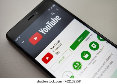 Berlin, Germany - November 19, 2017: YouTube application on screen of modern smartphone. Install menu of YouTube app in Play Store