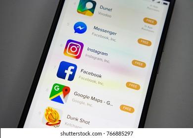 Berlin, Germany - November 19, 2017: Popular application on screen modern smartphone. Top apps icon on display mobile phone. Messenger, Viber, Instagram, facebook, google maps