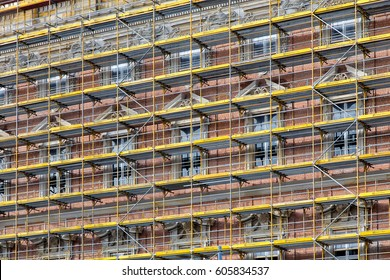 Berlin, Germany - November 2016: Huge yellow scaffolding - building facade on new Berlin City Palace construction site. City Palace was an imperial palace in the heart of Berlin.