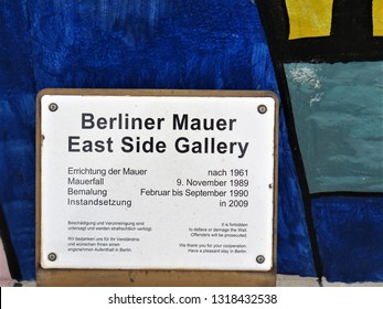 Berlin, Germany - November 2016: Sign of the East Side Gallery, an open-air gallery in Berlin. It consists of a series of murals painted directly on a 1316 m long remnant of the Berlin Wall.