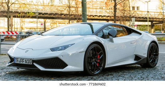 Berlin, Germany - November, 2017: White Lamborghini Huracan Spyder supercar with black alloy wheels on a road in Berlin.