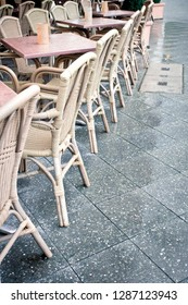 Berlin, Germany - November 26 2015: A row of tables and chairs at a street cafe