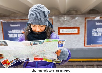 Berlin , Germany - November  28, 2016: Girl looks at the map of the city of Berlin in the subway