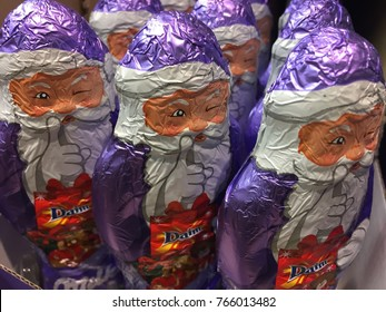 Berlin, Germany - November 28, 2017: Milka Chocolate Santa Claus figurines. Traditional Swiss brand of chocolate confection, Milka is sold in bars and a number of novelty shapes for Easter and Xmas