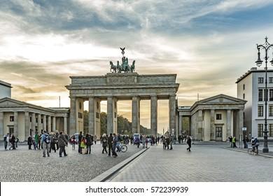 BERLIN, GERMANY - OCT 27, 2014: people admire Brandenburg Gate (Brandenburger Tor) in Berlin in late afternoon