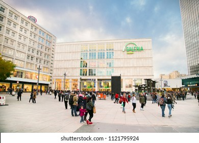 BERLIN GERMANY - OCT 29, 2016: People near fountain on Alexanderplatz square in Berlin city on Oct 29, 2016. Germany. Alexanderplatz is large public square and transport hub in central Mitte district