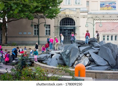 BERLIN, GERMANY - OCTOBER 01, 2012 : Unidentified children are playing near the entrance to Zoo- Aquarium in Berlin, on October 01, 2012. Berlin Zoo is one of the biggest  Zoo garden  worldwide.