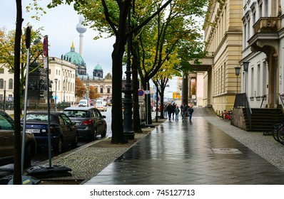 Berlin, Germany - October 10, 2017: Tourists walking by Unter den Linden boulevard near the Berlin Cathedral. Berlin TV Tower in fog