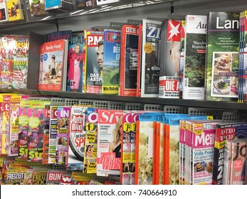 Berlin, Germany - October 11, 2017: newsstand interior, cover pages of German magazines displayed for sale on a stand