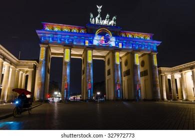 BERLIN, GERMANY - OCTOBER 13, 2015: Brandenburg Gate in night illumination. The annual Festival of Lights 2015