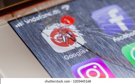 BERLIN, GERMANY - OCTOBER 15, 2018: Google Plus app on a broken screen of an iPhone 7 Plus with personalized background, symbolic for system failure or defect