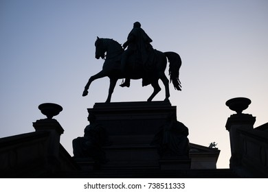 BERLIN, GERMANY - OCTOBER 16, 2017: bronze equestrian statue of King Friedrich Wilhelm IV of Prussia in front of the Alte Nationalgalerie (Old National Gallery), silhouetted at dusk.