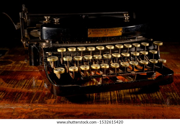 Berlin, Germany - October 16, 2019: Detail of a historic dusty portable typewriter made in Germany during the twenties of the 20th century.