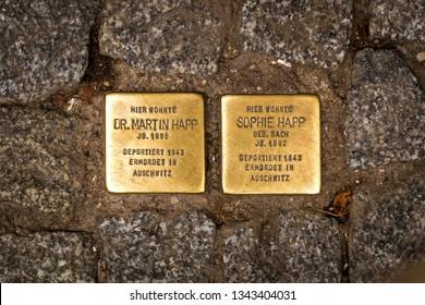 Berlin, Germany - October 18, 2014: Memorial stones called Stolpersteine of stumbling blocks commemorate: Martin Happ Sophie Happ, murdered by the Nazis. Berlin, Germany, Europe