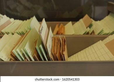 BERLIN / GERMANY - October 20, 2018: File with colored paper files sorted in box in the former Stasi headquarter