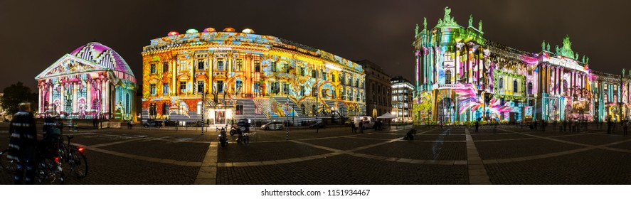 Berlin, Germany - October 2017:  Panoramic shot of illuminated Humboldt University of Berlin, Hotel de Rome, and St. Hedwig's Cathedral at Bebelplatz; Festival of Lights