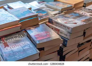 Berlin, Germany - October 22, 2018: Many used and stacked German books that were sorted out after reading.