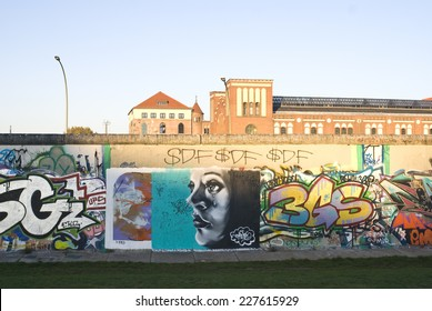 BERLIN, GERMANY - OCTOBER 25, 2014: Fragment of East Side Gallery in Berlin. It's a 1.3 km long part of original Berlin Wall which collapsed in 1989 and now is the largest world graffiti gallery