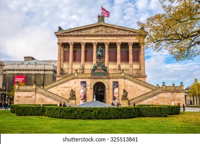 Berlin, Germany - October 26, 2013: Exterior view of Alte Nationalgalerie (Old National Gallery) on the Museumsinsel in Berlin-Mitte. The Pergamon museum on the left in the background.