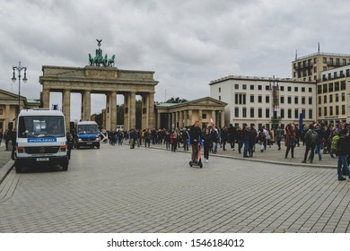 Berlin, germany - october 27 2019: Wide view of pariser square mood with people, police and brandeburg gate in background, berlin deutschland
