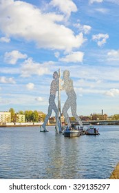 Berlin, Germany - October 29, 2013: Molecule Man sculpture by Jonathan Borofsky. The sculpture represent the intersection of the districts Treptow, Kreuzberg and Friedrichshain.