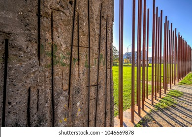 Berlin, Germany - October 30 2017: Berlin Wall Memorial on a sunny day with focus on the exposed core ten steel vertical rods