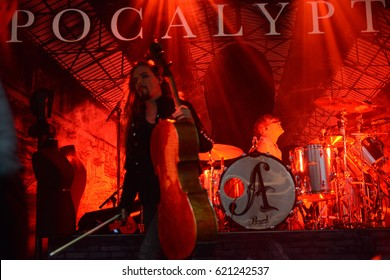 Berlin, Berlin / Germany October 5, 2015: Apocalyptica, cellos metal band from Helsinki (Finland)), with its cellos player Perttu Paivo Kullervo Kivilaakso and drummer at Columbia Halle in 2015.