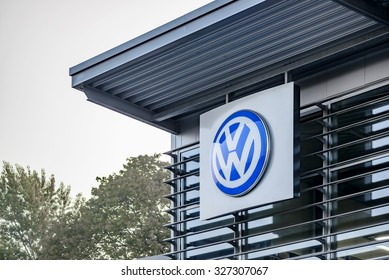 """BERLIN, GERMANY - OCTOBER 5: the VW logo of the brand """"Volkswagen"""" at a car dealer building on Oct 5, 2015 in Berlin, Germany, Europe. Volkswagen AG is a German automotive manufacturing company."""